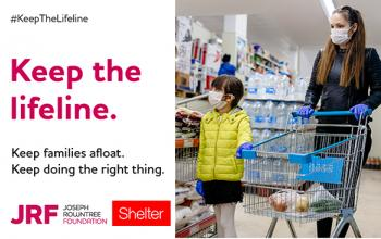 Women and child walking through supermarket. Writing over image 'Keep the lifeline. Keep families afload'